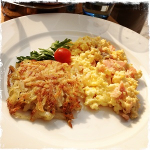 Scrambled eggs with smoked salmon and a side of hash browns. It smelled divine.