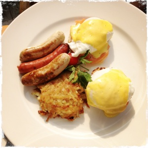 """Eggs benedict with hash browns and beef sausage. All of which, I was told, were """"rather good indeed."""""""