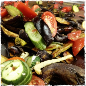 Grilled aubergine and zucchini with tomatoes, cucumber and a bit of onion.